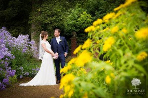 kirknewton house stables wedding photography - Bride and groom portrait in the stunning gardens
